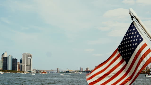 Beautiful view from the boar on Manhattan in New York, USA. American flag waving on the wind, East river video