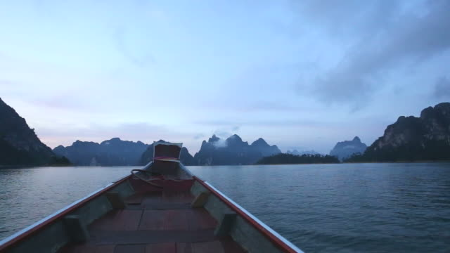 Beautiful view lime stone mountain lake and river from boat in Ratchaprapa dam , Khoa sok national park , Surat thani ,Thailand video