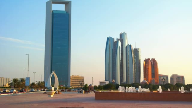 beautiful view of abu dhabi city corniche, towers and architecture - uae national day стоковые видео и кадры b-roll