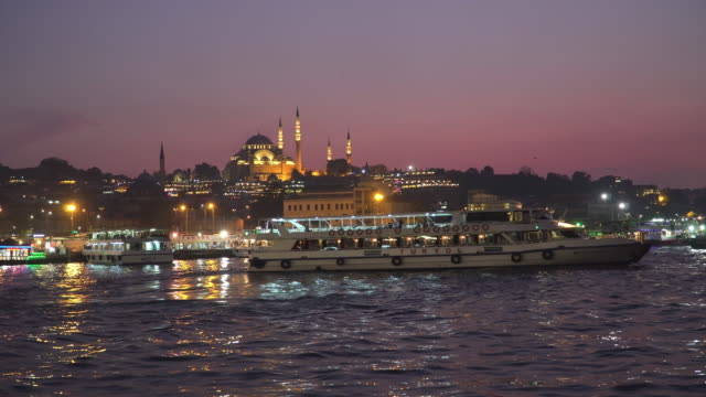 Beautiful View of touristic landmarks at at Eminönü (Turyol)  harbour at sunset among air pollution