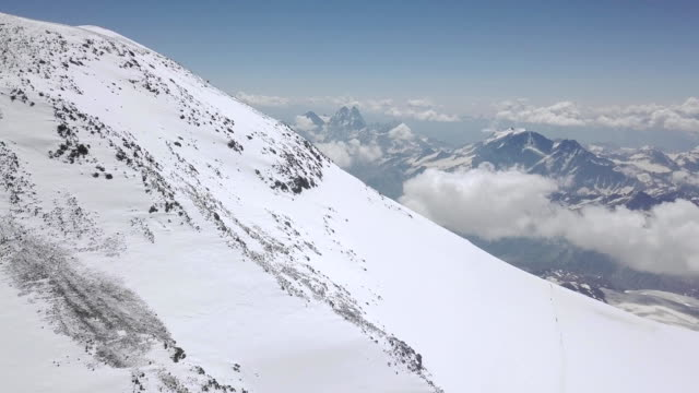 Beautiful view snow peak mountain. Top view amazing landscape winter mountain video