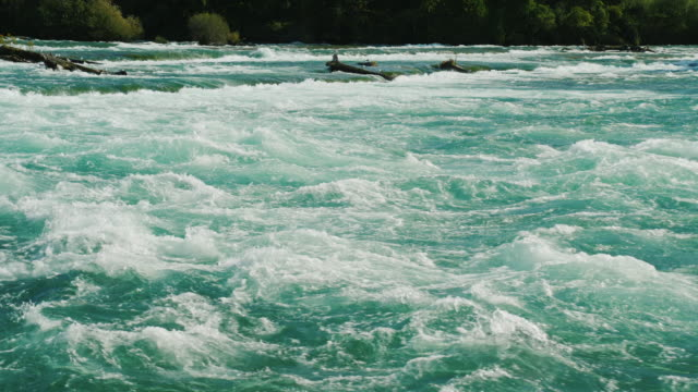 Beautiful water of the Niagara River. A clean river with a strong current in front of Niagara Falls video