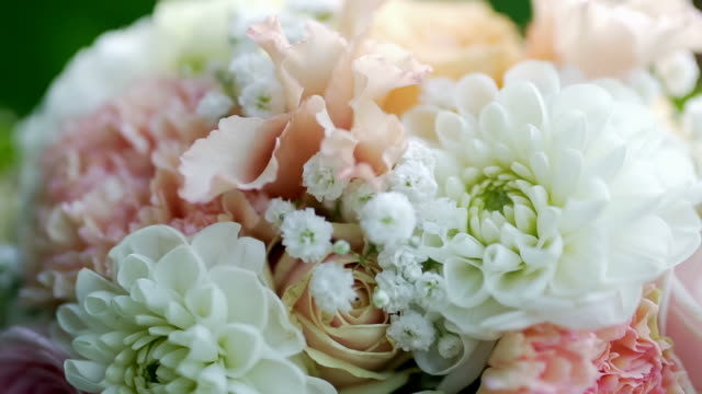 beautiful wedding bouquet on a background of foliage video