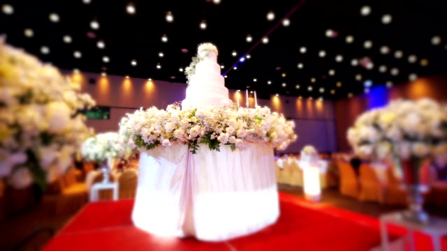 Beautiful wedding cake decorated with flowers at wedding reception. video