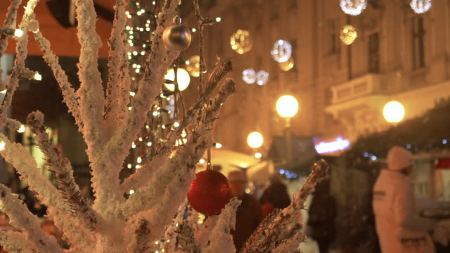 CLOSE UP: Beautiful white Christmas tree stands near a busy street in Zagreb.