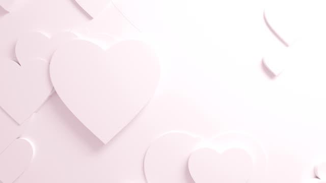 Schönen weißen Herzen auf die Oberfläche bewegt sich in nahtloser 3d Animation. Abstrakte Motion Design-Hintergrund. Computer generierte Prozess. 4k UHD 3840 x 2160. – Video