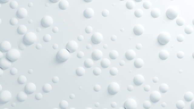 vídeos de stock e filmes b-roll de beautiful white spheres on surface moving in seamless 3d animation. abstract motion design background. computer generated process. 4k uhd 3840x2160. - white wall