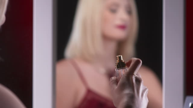 HD: Beautiful Woman Applying Fragrance video