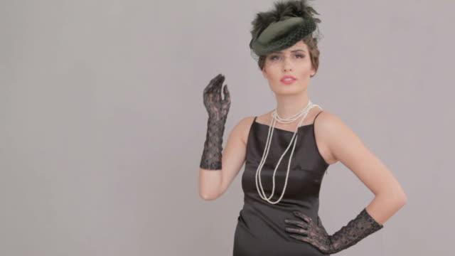 Beautiful woman at vintage photo shooting video