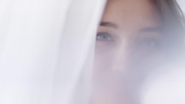 Beautiful Woman behind Tulle Curtain video