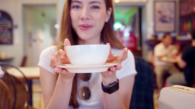 Beautiful woman Blogger or YouTube's Live  is talking and gesturing recording video with professional camera for internet blog , girl is wearing casual clothing live streaming viral online with  Food Review