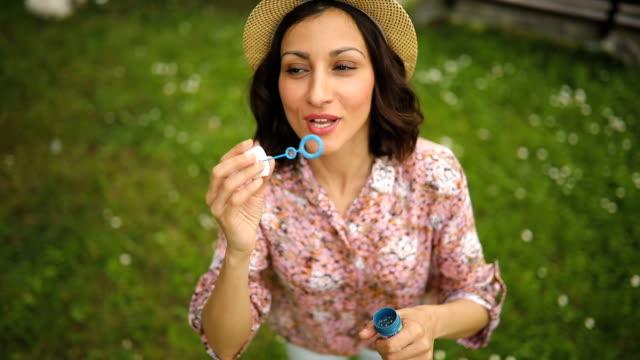Beautiful woman Blowing bubbles video