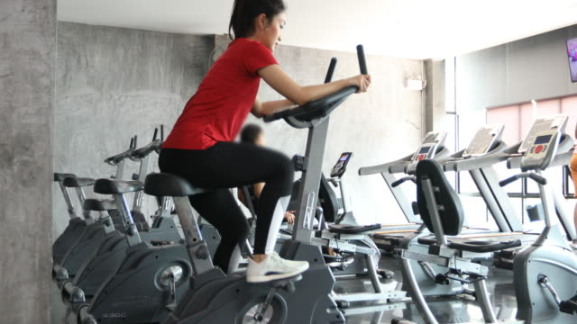 beautiful woman cycling on the exercise bike in the gym beautiful woman cycling on the exercise bike in the gym exercise bike stock videos & royalty-free footage