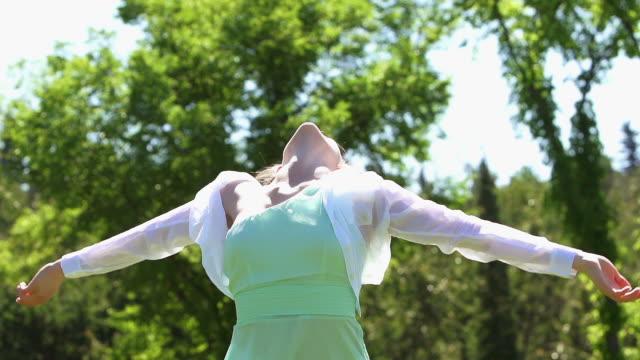 Beautiful woman dances in freedom video