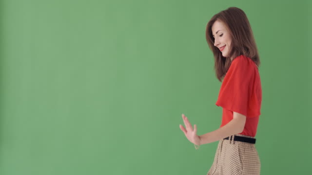 beautiful woman dancing over green background - comparsa video stock e b–roll