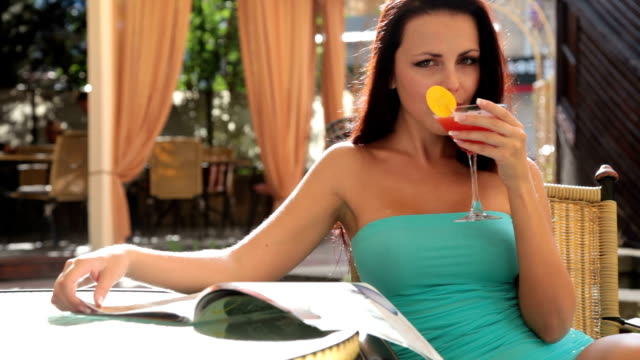 beautiful woman enjoying a cocktail video