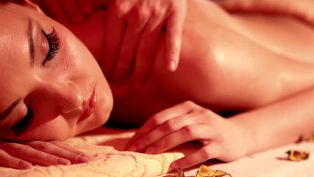 Beautiful woman enjoying massage steady shot video