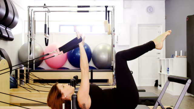 beautiful woman exercising in fitness studio - metodo pilates video stock e b–roll
