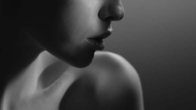 Video Beautiful woman face close up studio. Fashion Video. Slow Motion.