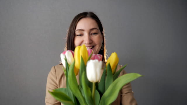 Beautiful woman gets bouquet of tulips