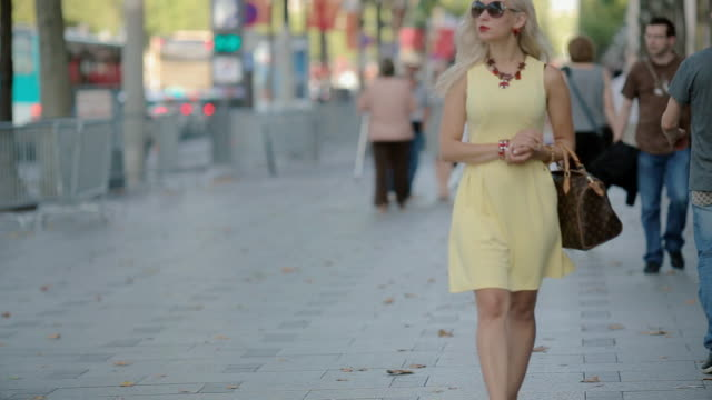 beautiful woman going along the street - paris fashion stock videos & royalty-free footage
