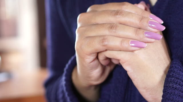 beautiful woman hand praying peacefully in church, video