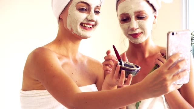 beautiful woman having a facial treatment at spa. - derma video stock e b–roll