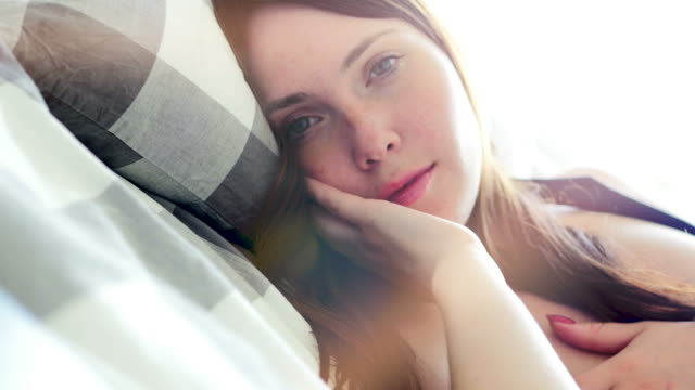 beautiful woman having leisure time at her home. enjoying free day and being cheerful, happy and relaxed. - negligenza video stock e b–roll