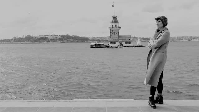 Beautiful woman in front of maiden's tower view in Istanbul city