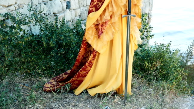 Beautiful woman in medieval dress with sword video