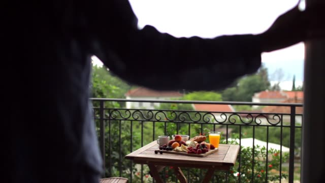 beautiful woman in pajamas having breakfast on the terrace