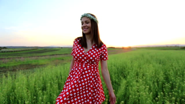 Beautiful woman in polka dot dress video