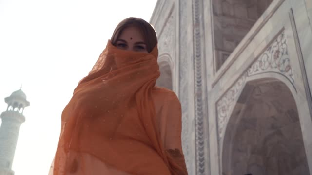 Beautiful Woman in traditional Sari in front of Taj Mahal. background, Agra, Uttar Pradesh, India Beautiful Woman in traditional Sari in front of Taj Mahal. background, Agra, Uttar Pradesh, India. sari stock videos & royalty-free footage