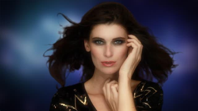 Beautiful woman on blue background video