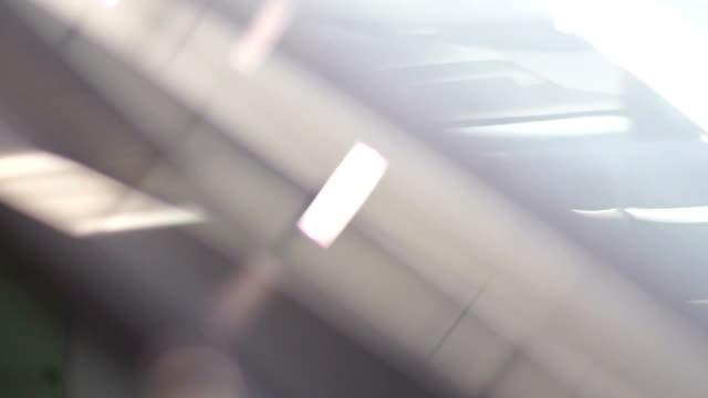 Beautiful woman posing behind the wheel of a car video