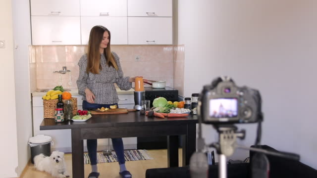 Beautiful woman preparing healthy homemade juice and talking about healthy lifestyle