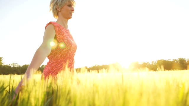 HD SUPER SLOW MO: Beautiful Woman Running In Field video