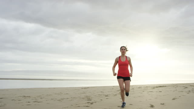 beautiful woman running on the beach - active lifestyle stock videos & royalty-free footage