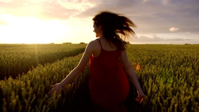 Beautiful woman running to meet the sunset