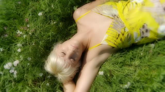 HD SLOW MOTION: Beautiful Woman Sleeping In A Meadow video