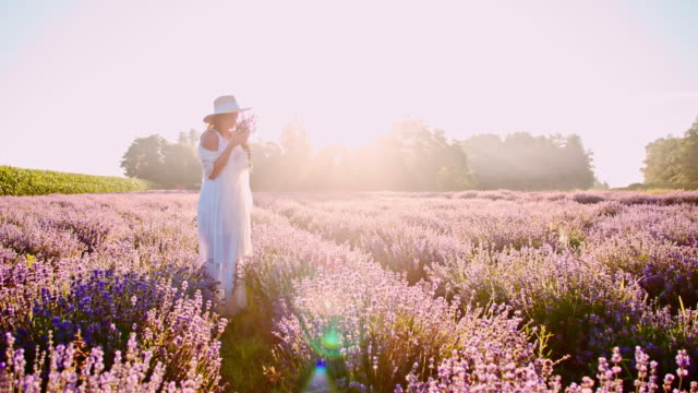 SLO MO Beautiful woman smelling lavender flowers video