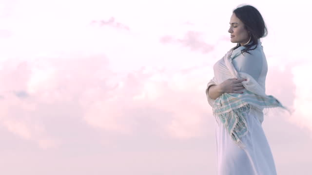 beautiful woman smiles with wonderful clouds in background: relaxation, relax video