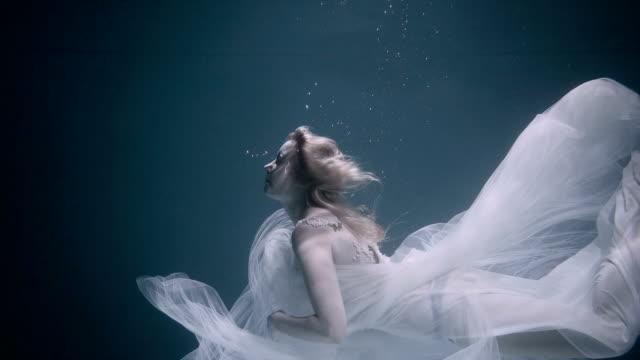 Beautiful woman swimming underwater in white elegant dress swimming underwater princess stock videos & royalty-free footage