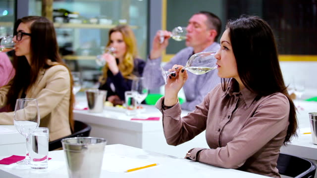 Beautiful woman tasting a white wine on degustation video