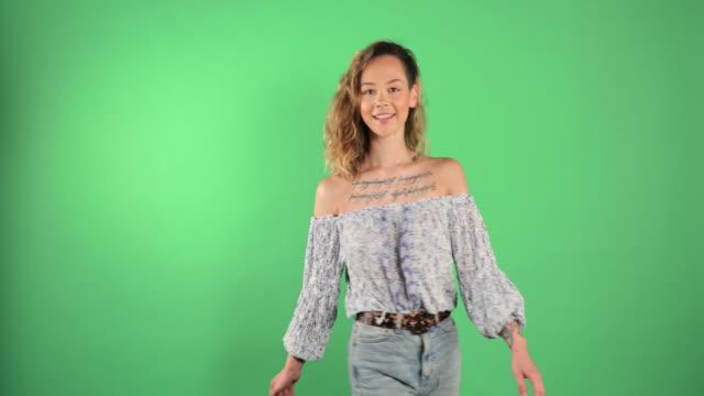 beautiful woman twirling - modelka i model filmów i materiałów b-roll