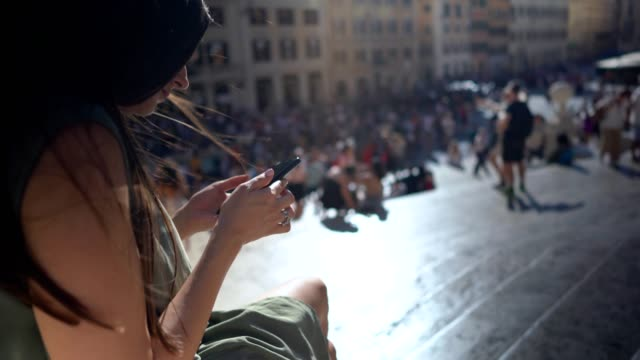 Beautiful woman using phone at Spanish steps, Rome