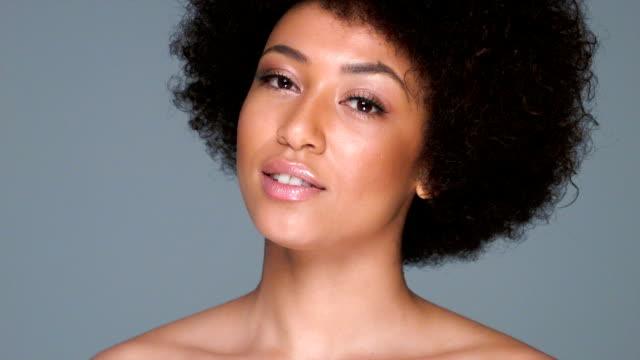Beautiful woman with an afro hairstyle video