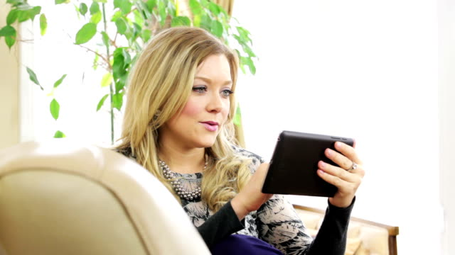 Beautiful woman with digital tablet video