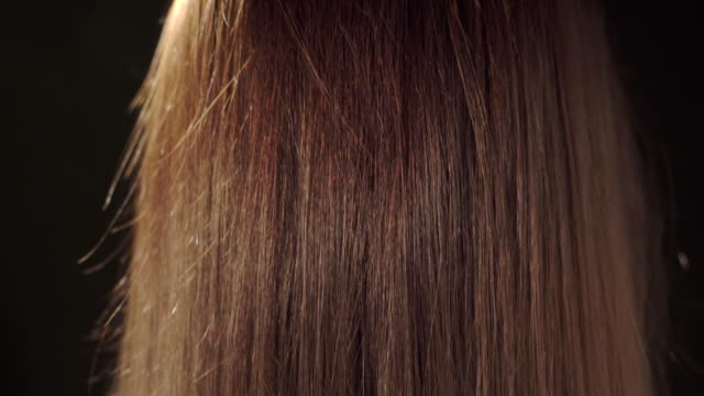 Beautiful woman with long brown straight hair rear view video
