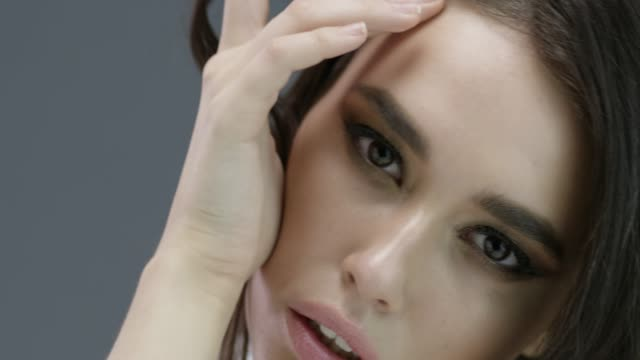 beautiful woman with natural make-up. perfect fashion models face. fashion video. - clavicola video stock e b–roll